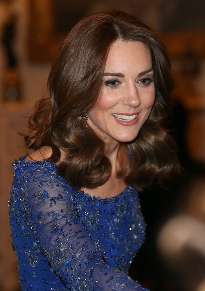 Kate Middleton's hair looked amazing in loose curls. Here, Catherine, Duchess of Cambridge smiles as...