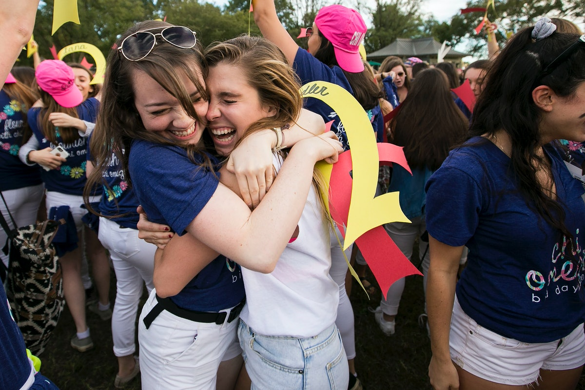 Members of Chi Omega sorority hug on Bid Day, which is a cute moment that should be shared on Instag...