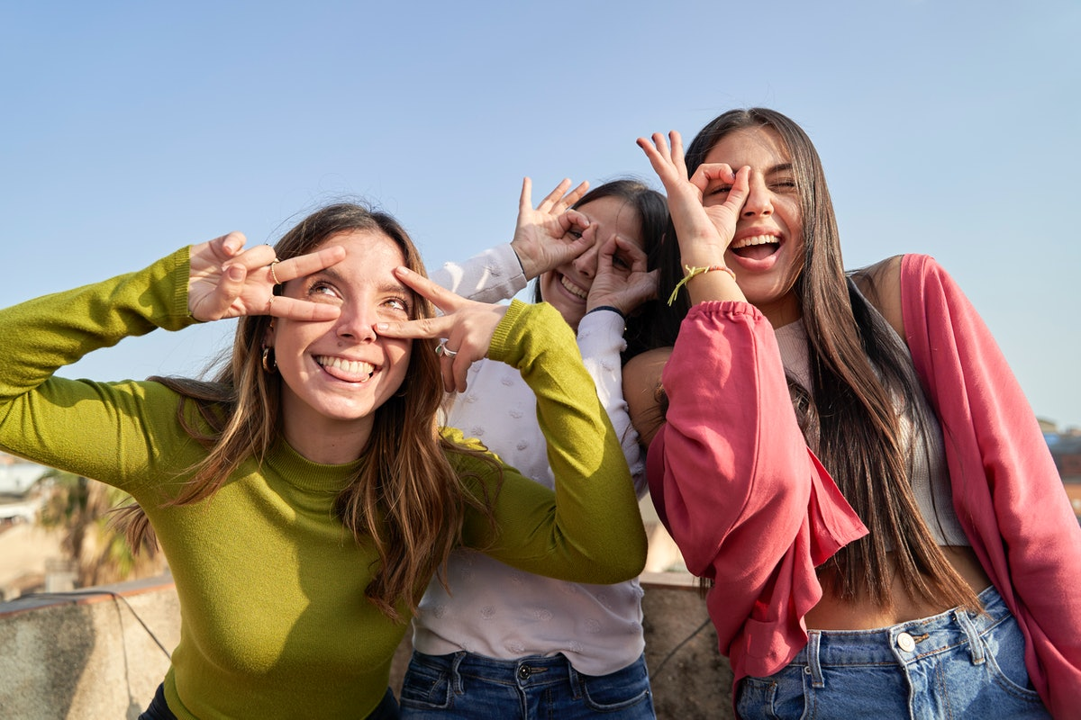 A group of friends celebrate on Bid Day with a selfie they can post on Instagram with sorority capti...
