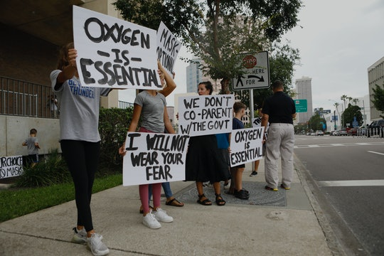 TAMPA, FL - JULY 27: Families protest any potential mask mandates before the Hillsborough County Sch...