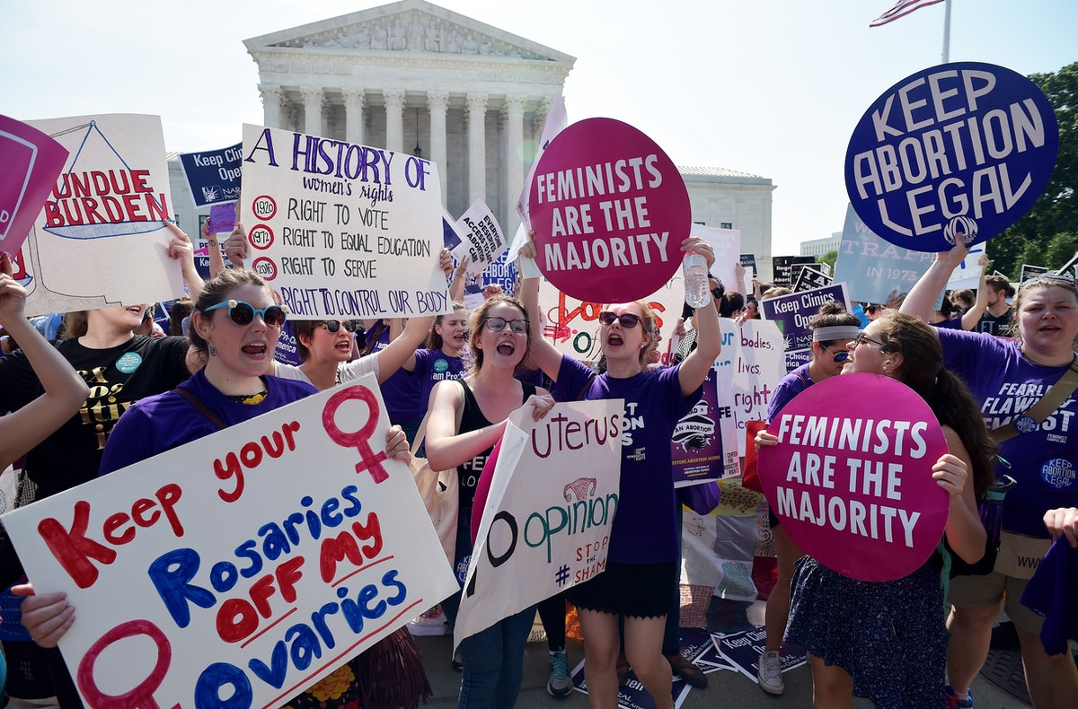 Abortion rights activists cheer after the US Supreme Court struck down a Texas law placing restricti...