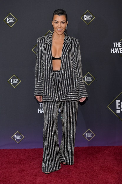 Kourtney Kardashian's 2000s outfits run the gamut from metallic mini dresses to lacy corset tops. Se...