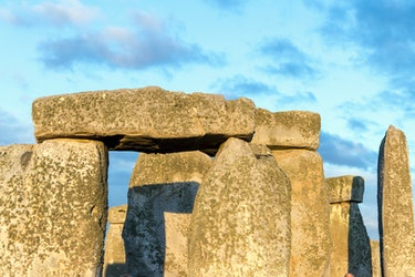 20th JUNE 2019 - SALISBURY, UK - Close-up of the ancient stone circle of Stonehenge, brightly lit by...