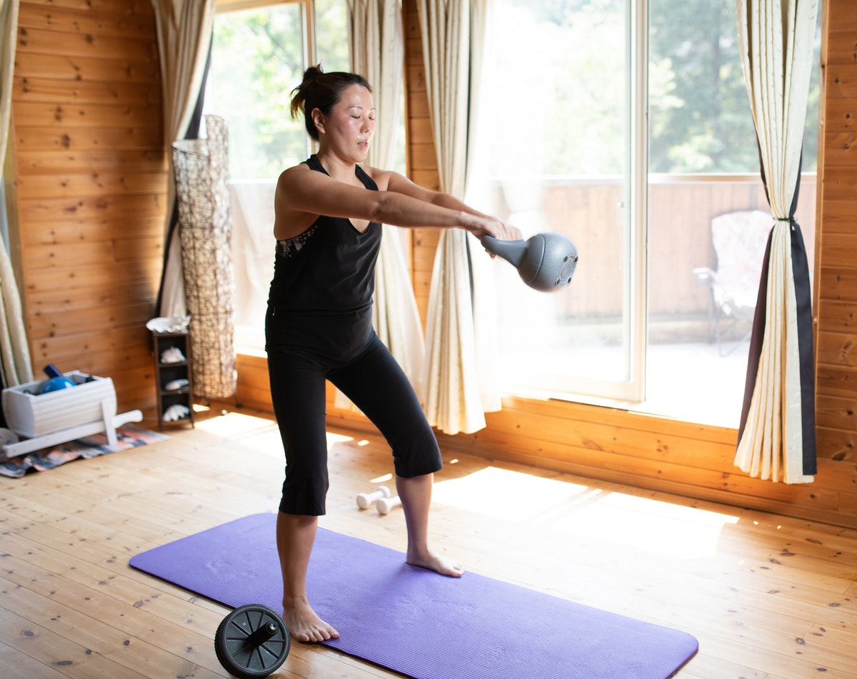 Using a kettlebell for the first time can be daunting, so try sweating through kettlebell workouts f...