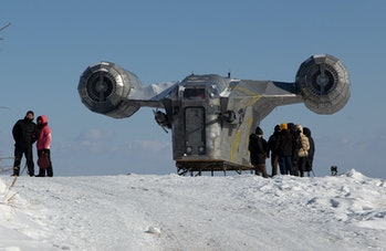 """People stand by a giant replica of the Razor Crest, a gunship from the StarWars spinoff series """"The ..."""
