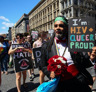 NEW YORK, NY - JUNE 30:  An activists holds a sign in support of sufferers of HIV during the Queer L...