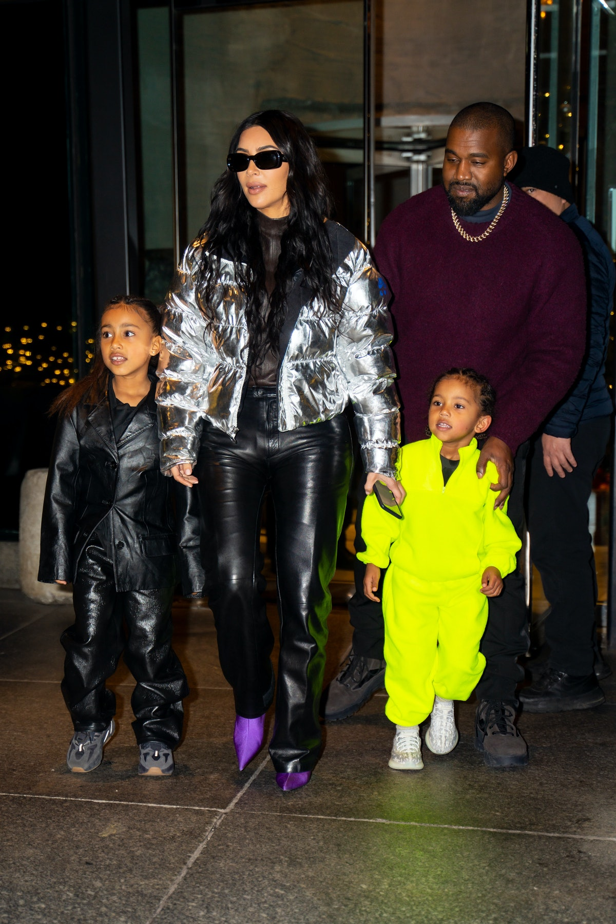 NEW YORK, NEW YORK - DECEMBER 21: (L-R) North West, Kim Kardashian, Kanye West and Saint West are se...