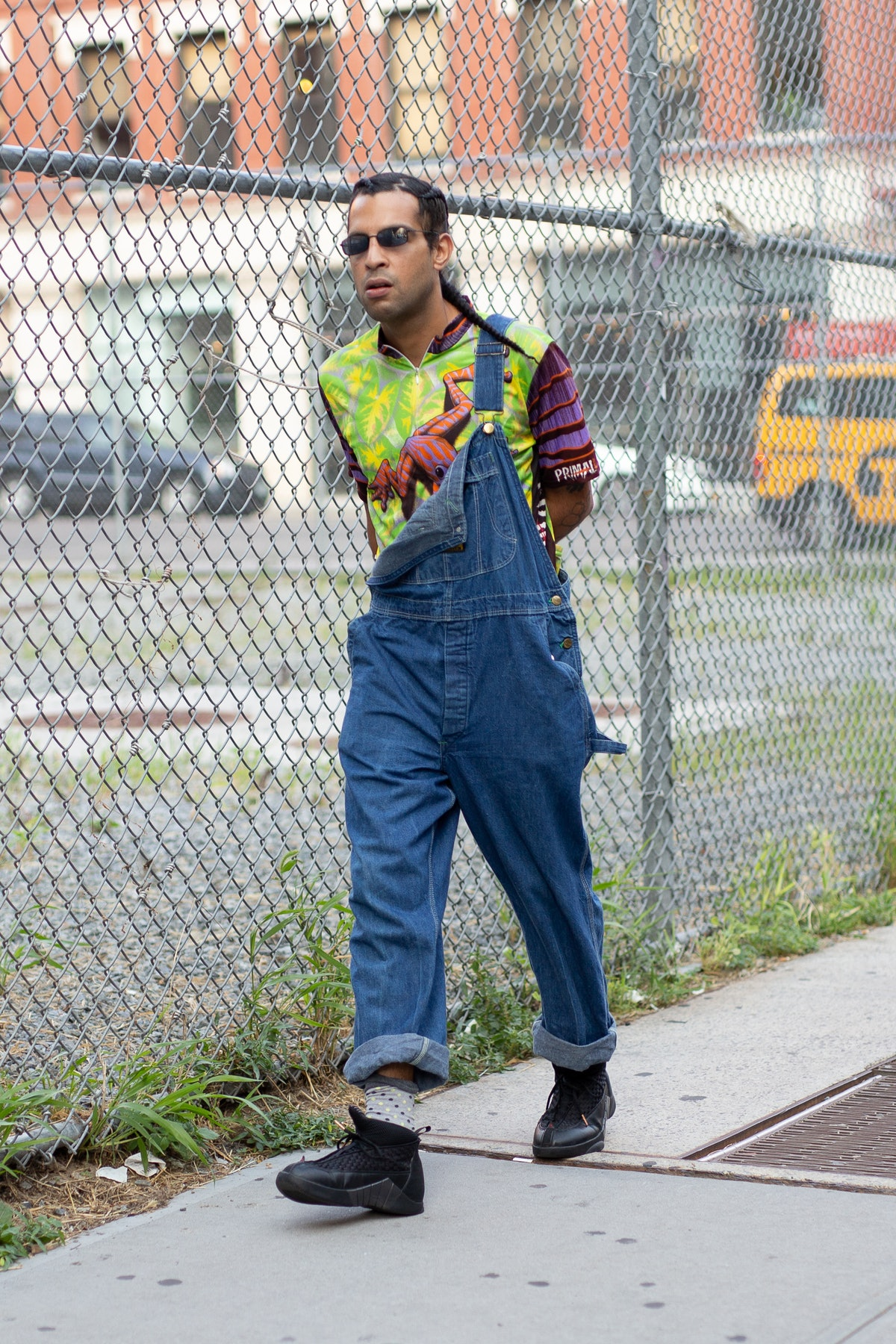 A guest is seen on the street during New York Fashion Week demonstrating a casual way to wear overal...