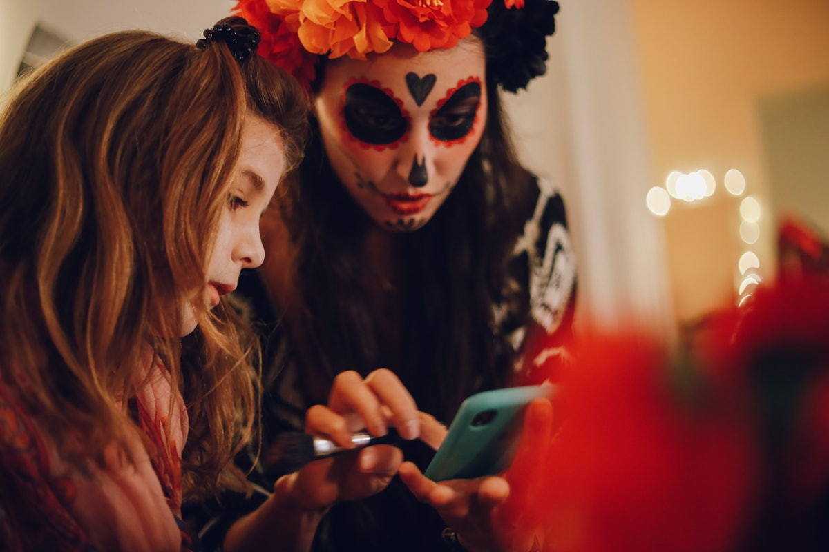 Two women send Halloween pickup lines to a match.