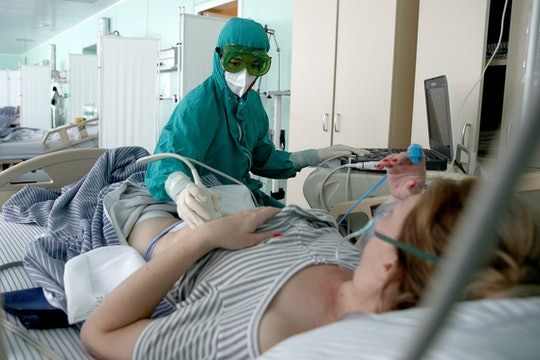 KAZAN, RUSSIA  AUGUST 5, 2021: Performing an ultrasound scan in a temporary obstetric facility for C...