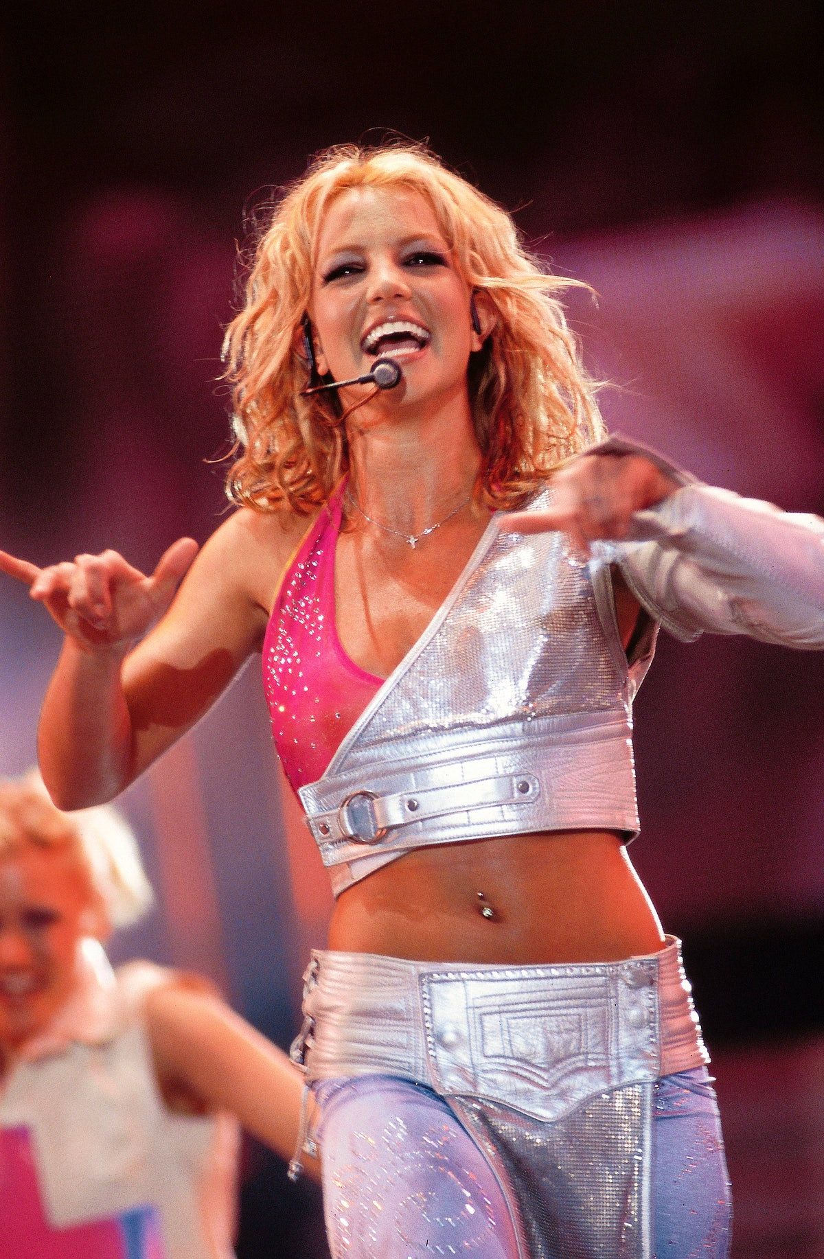 Britney Spears in 2001 wearing a sparkling denim set while performing.