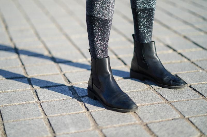 PARIS, FRANCE - JANUARY 10: Amanda Derhy wears gray shiny glitter socks from Intimissimi, black leat...