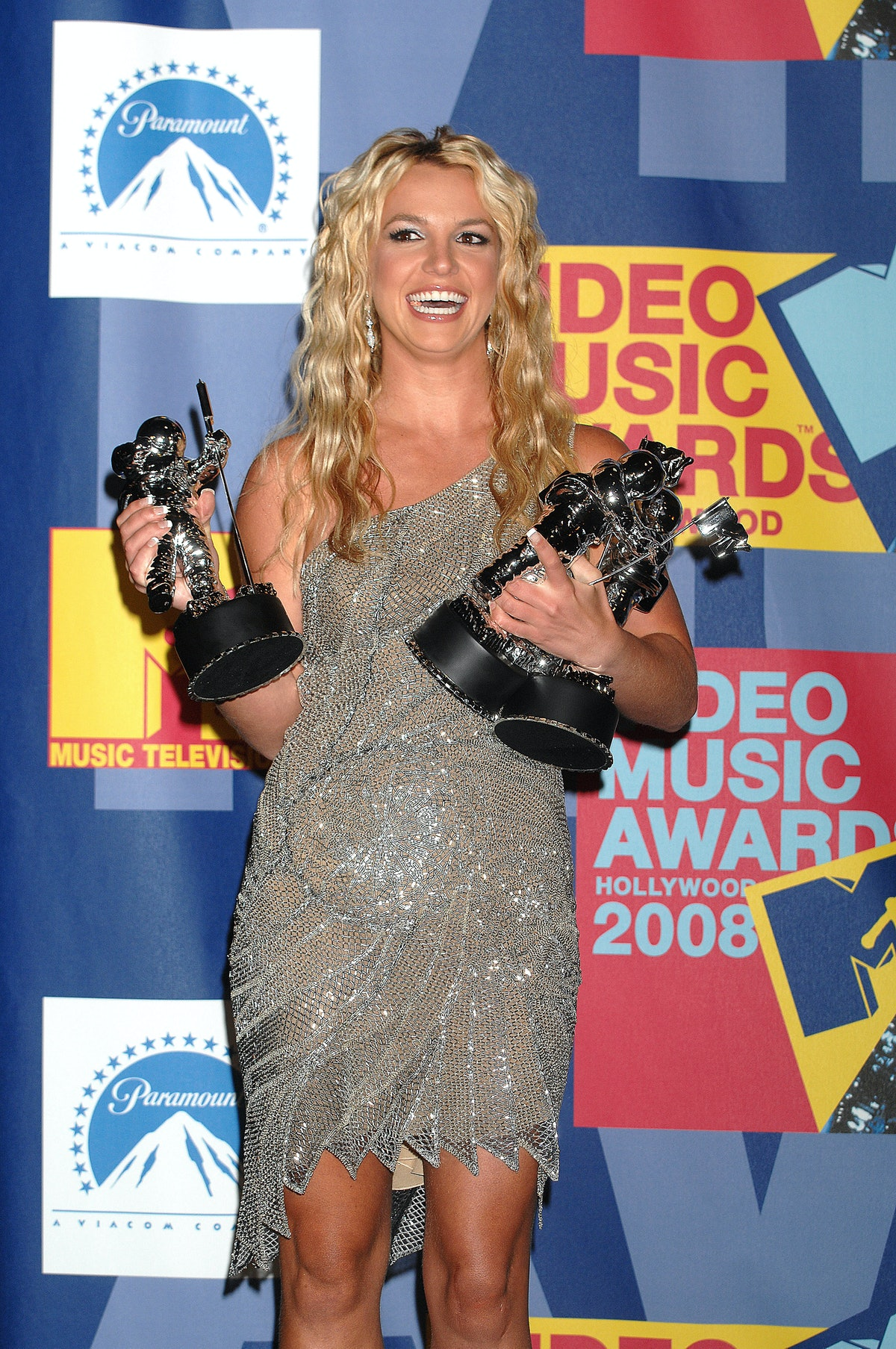 Singer Britney Spears poses with her Moonman trophies for Video of the Year, Best Female Video and B...