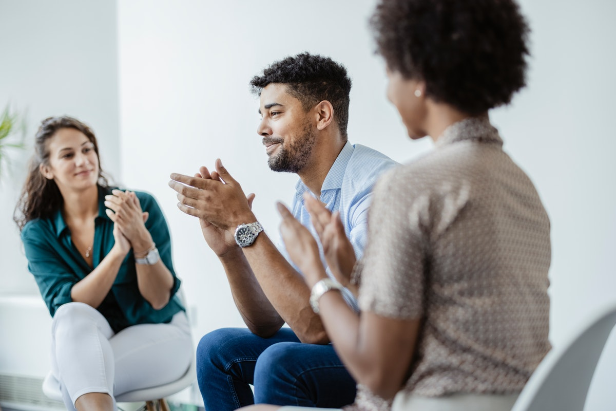 A couple seeking therapy supports each other during open communication.