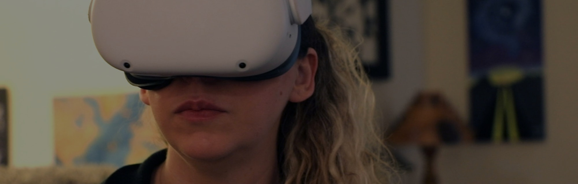 Amy Erdt, a community leader in the virtual reality space, sits in her living room and travels to fo...
