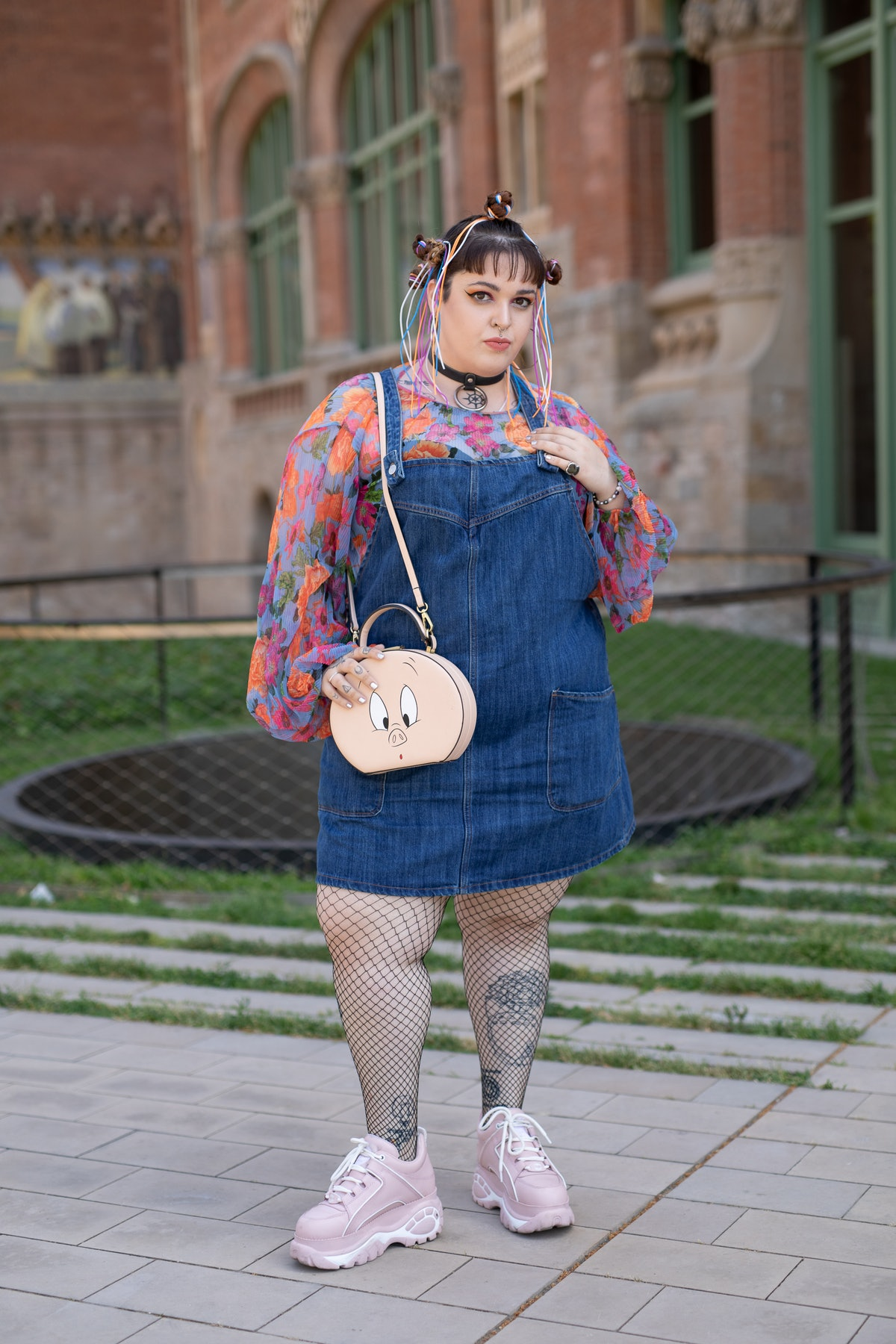 Plus-size influencer beautifully styles a pair of denim overalls as a dress with a long sleeve top, ...