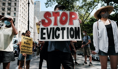 NEW YORK, NEW YORK - AUGUST 11: Activists hold a protest against evictions near City Hall on August ...