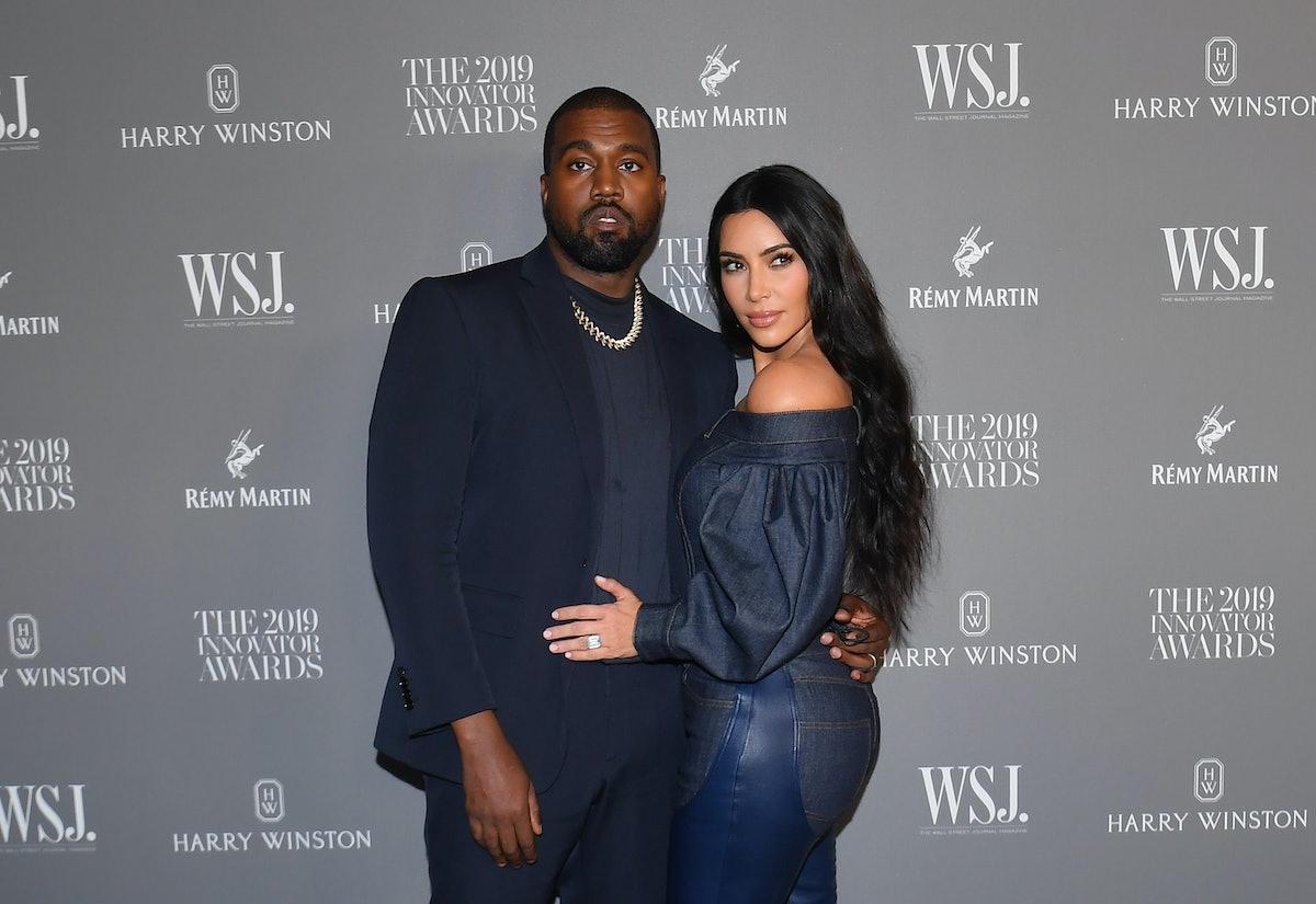 US media personality Kim Kardashian West (R) and husband US rapper Kanye West attend the WSJ Magazin...