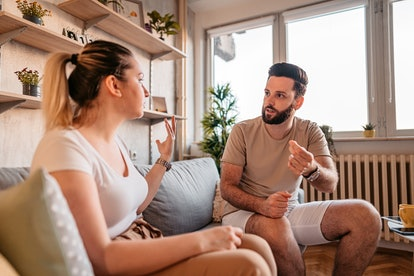 A couple fights while on the couch at home. Emotional blackmail is a sign of manipulation in a relat...