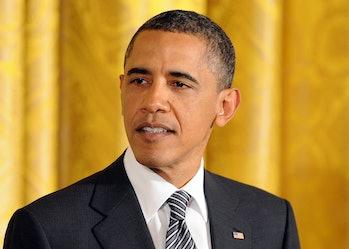 US President Barack Obama speaks as House Speaker John Boehnerat and Nancy Pelosi (both not pictured...