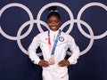 TOKYO, JAPAN - AUGUST 03: Simone Biles of Team United States poses with the bronze medal following t...