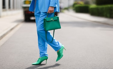DUSSELDORF, GERMANY - MAY 03: Isabel Lapp wearing blue Aggi suit, Zara shoes and green Hermes Kelly ...