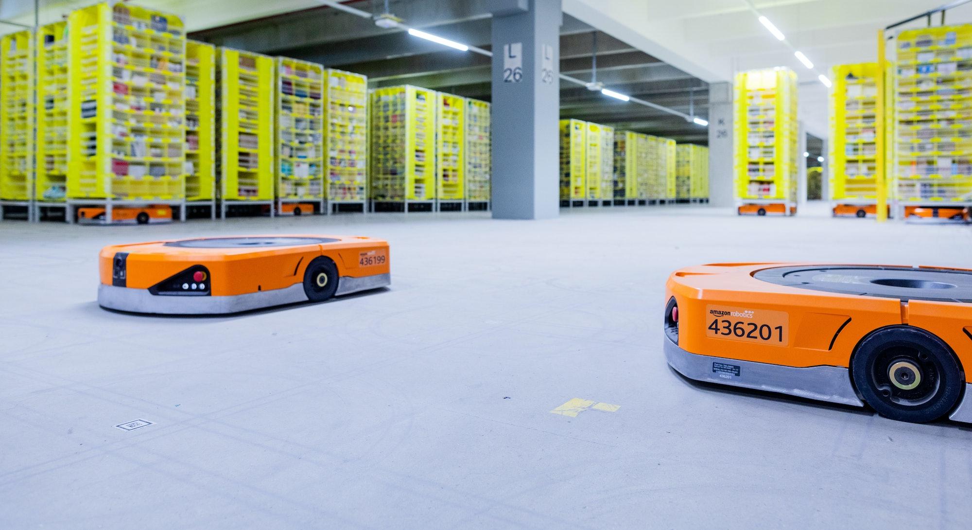 08 December 2020, North Rhine-Westphalia, Mönchengladbach: Robots transport goods to the employees i...