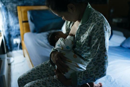 mom breastfeeding at night
