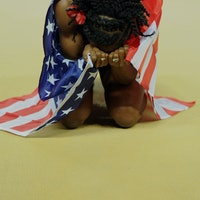 US athlete Chaunte Lowe celebrates winning the gold medal in the women's high jump final at the 2012...