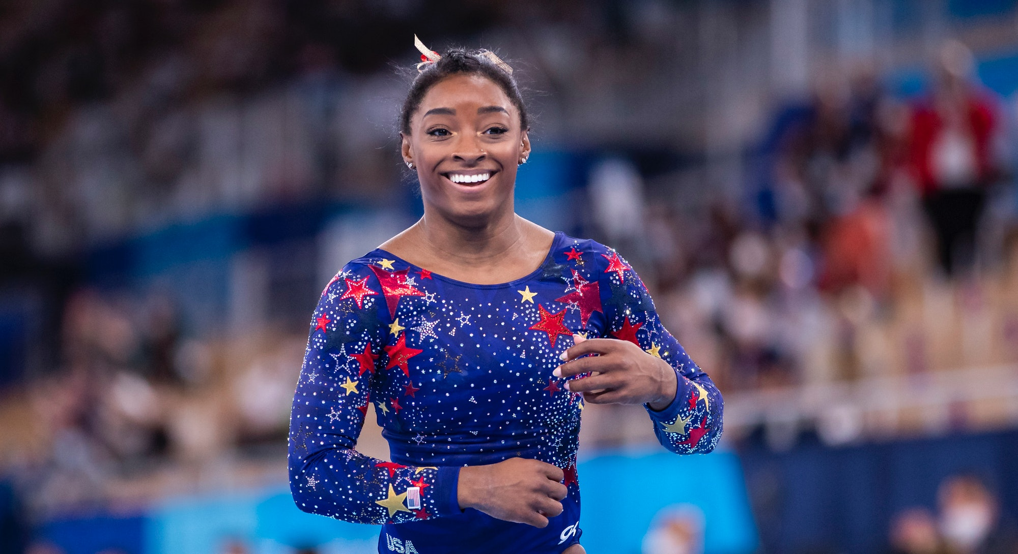 All 8 of the Team USA Olympics Gymnastics uniforms in 2021 were made by GK Elite. Find the meaning b...