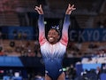 Tokyo, Japan, Tuesday, August 3, 2021 - USA gymnast Simone Biles performs smiles as she lands her di...