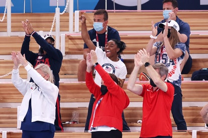 Simone Biles cheers on her teammates at the Tokyo Olympics.