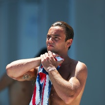 BARCELONA, SPAIN - JULY 28:  Tom Daley of Great Britain stretches his arm during the Men's 10m Platf...