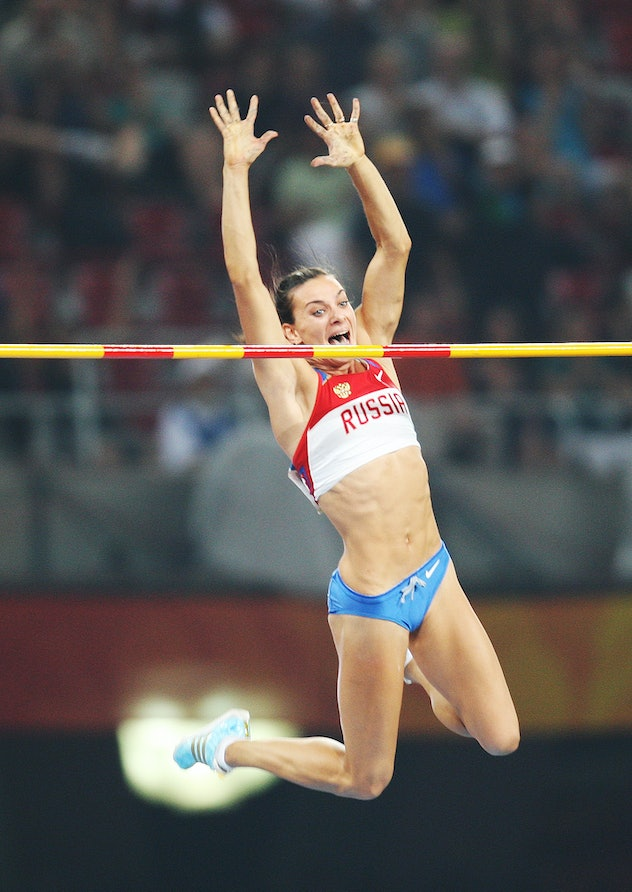 BEIJING - AUGUST 18: Elena Isinbaeva of Russia celebrates successfully jumping a new World Record of...