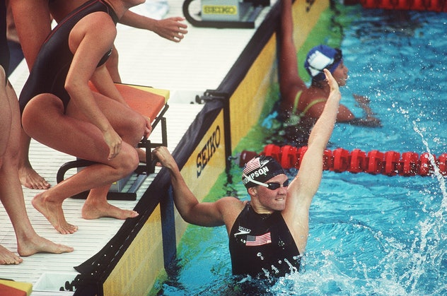 THE WOMENS 4 X 100M FREESTYLE TEAM CELEBRATE AFTER WINNING THE GOLD MEDAL AND BREAKING THE WORLD REC...