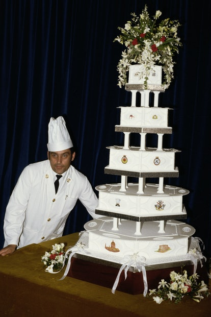 Chief petty officer cook David Avery with the royal wedding cake made for Prince Charles and Princes...