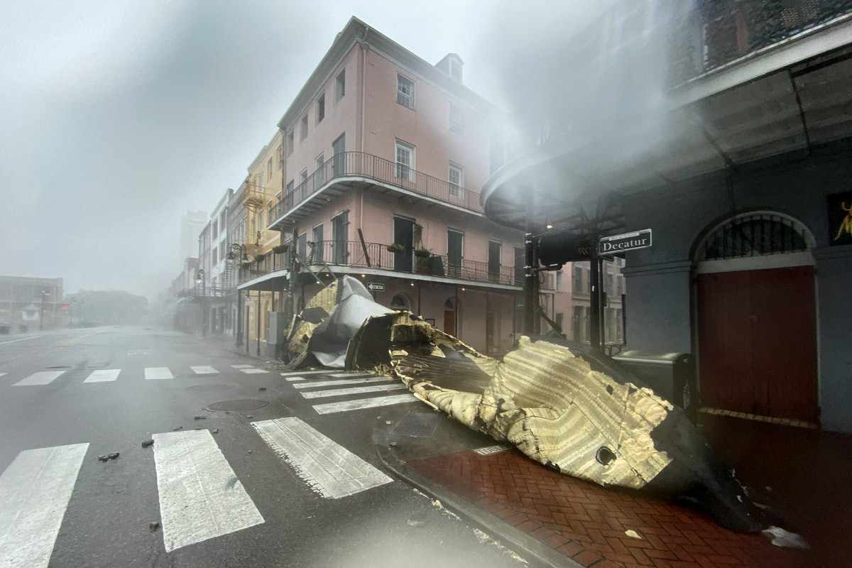 TOPSHOT - A section of a building's roof is seen after being blown off during rain and winds in the ...