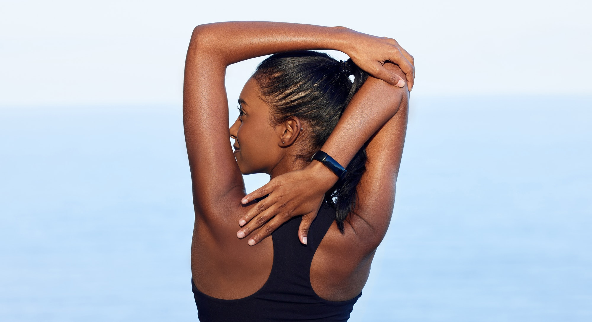 Trainers share the best stretches for upper back pain.