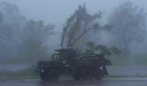TOPSHOT - A truck is seen in heavy winds and rain from hurricane Ida in Bourg, Louisiana on August 2...