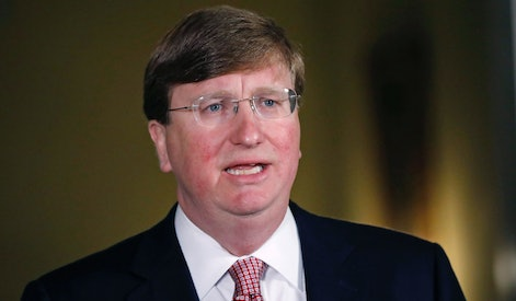 Mississippi Republican Gov. Tate Reeves delivers a televised address prior to signing a bill retirin...