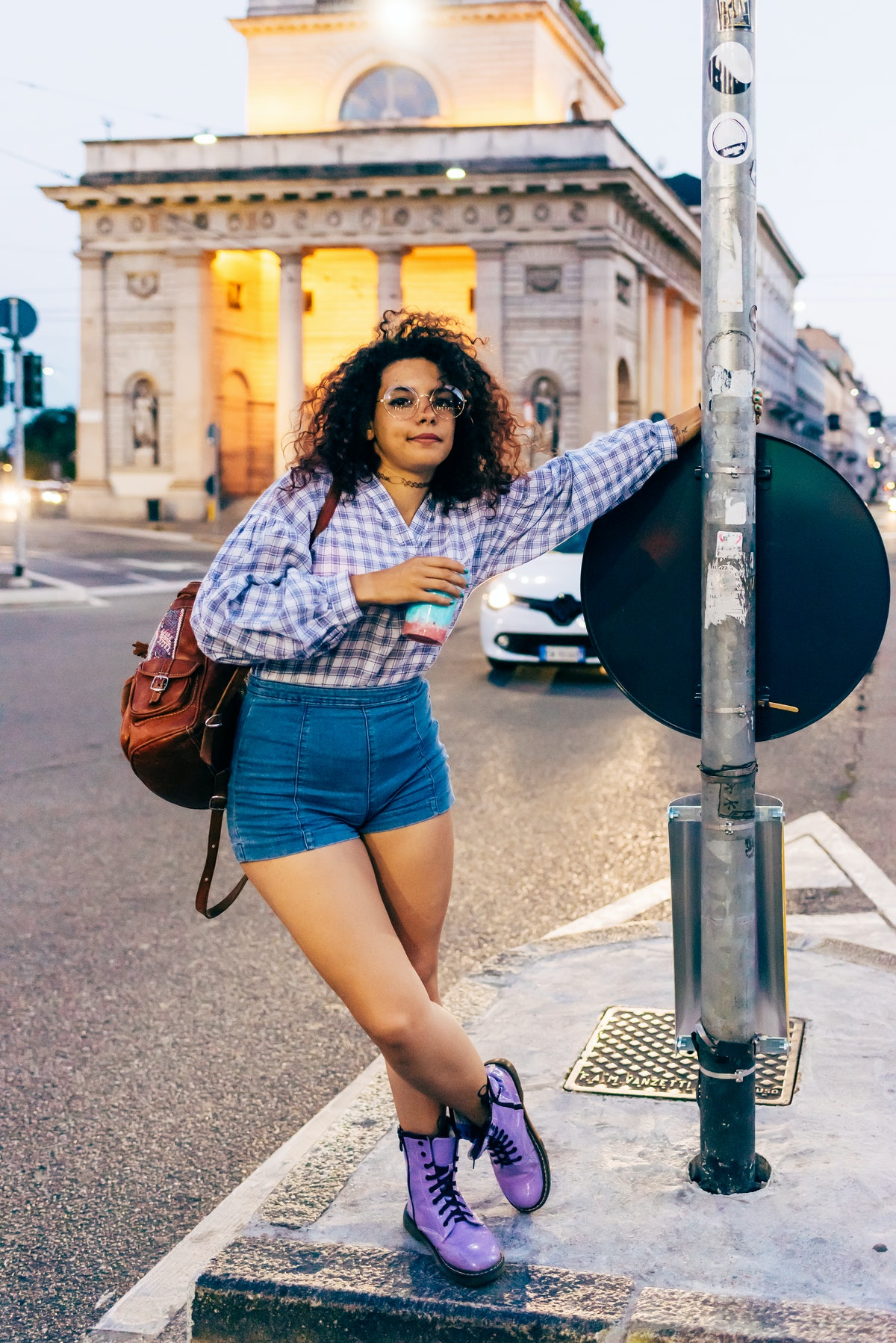 A woman poses for a travel photo that she can later share in a photo dump on Instagram with a vacati...