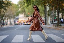 PARIS, FRANCE - AUGUST 25: Emilie Joseph @in_fashionwetrust wears black large sunglasses, silver ear...