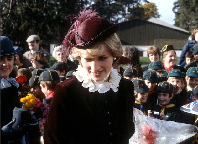 Princess Diana in maroon velvet.