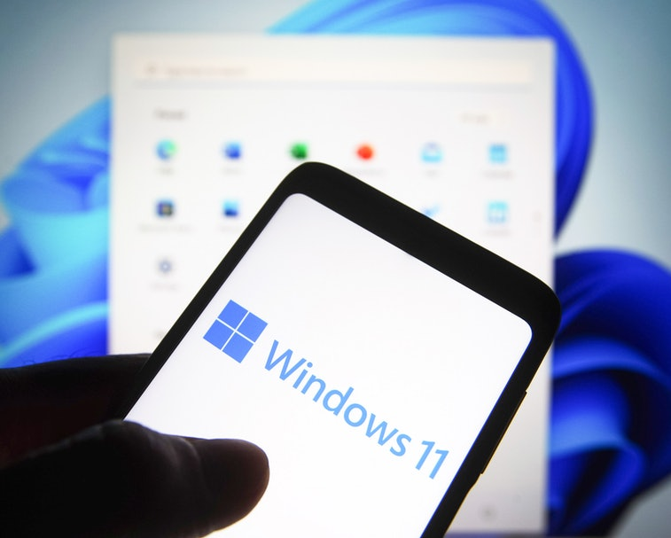UKRAINE - 2021/06/24: In this photo illustration a Windows 11 logo is seen on a smartphone screen wi...