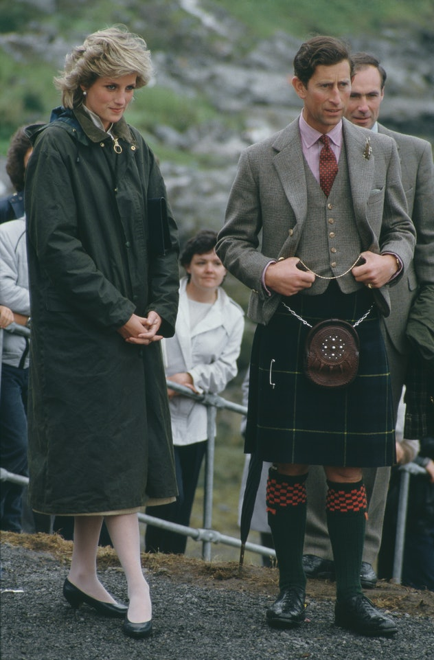Princess Diana wears a long coat in rainy weather.