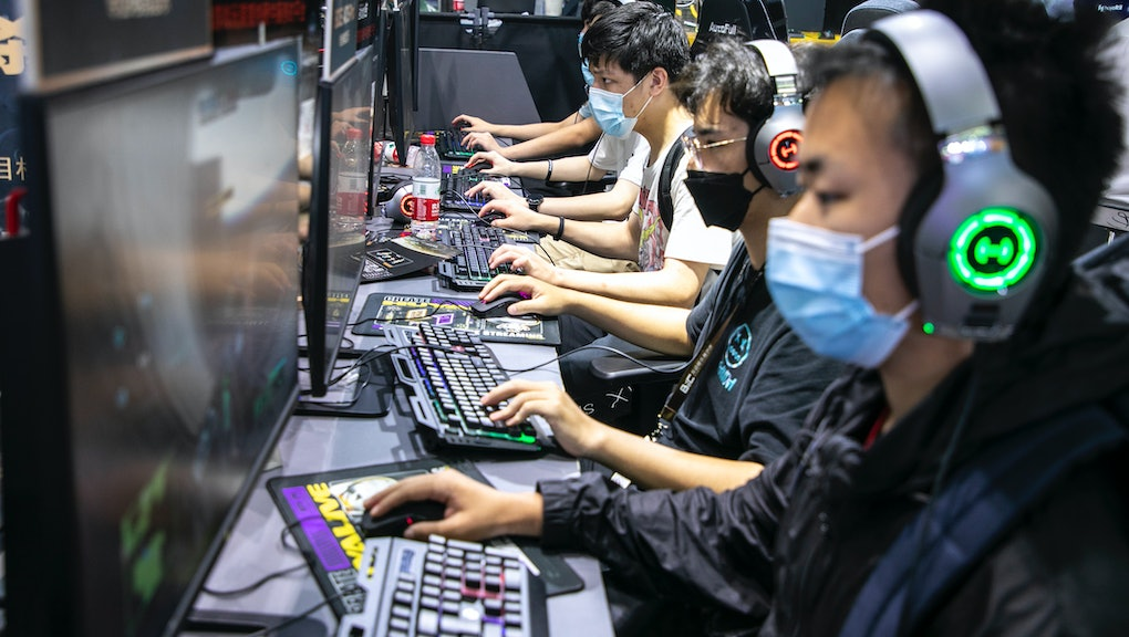 SHANGHAI, CHINA - JULY 31: People play online games at the booth of Huya, a Chinese live-streaming p...