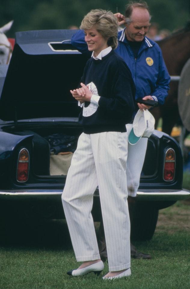 Princess Diana wearing navy and white.