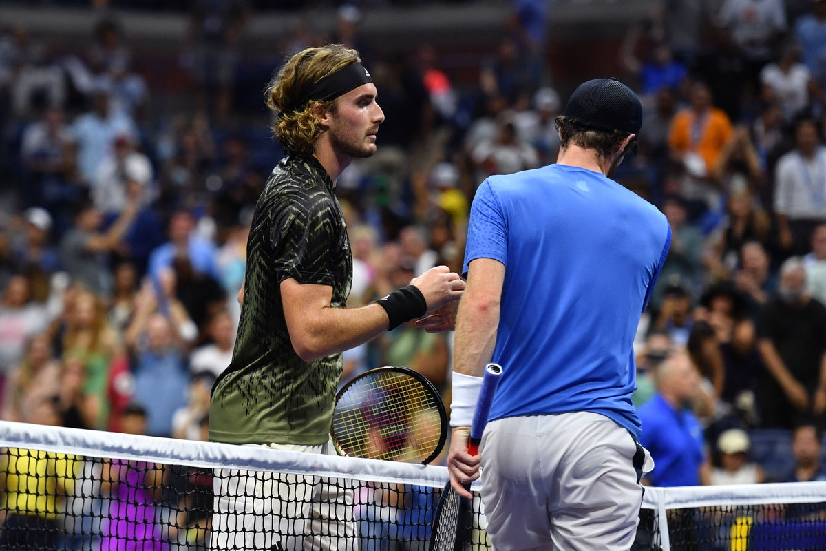 TOPSHOT - Greece's Stefanos Tsitsipas (L) shakes hands with Britain's Andy Murray after winning thei...
