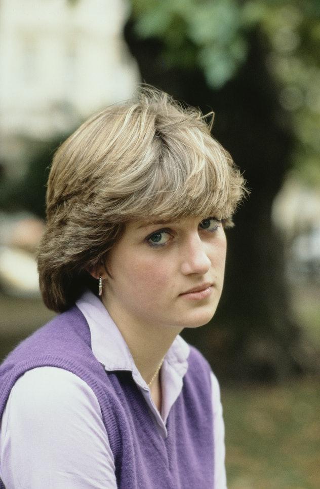 Lady Diana Spencer wears a purple sweater vest.