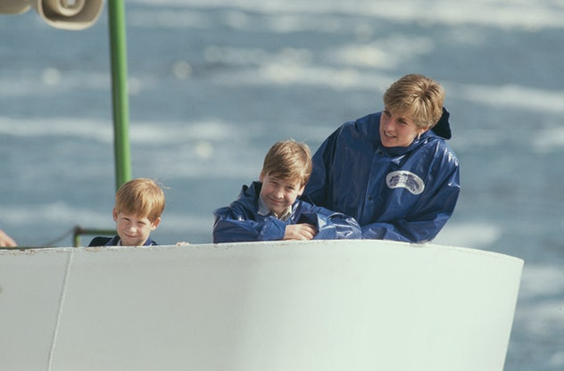 Princess Diana wore rain gear with her sons in Canada.